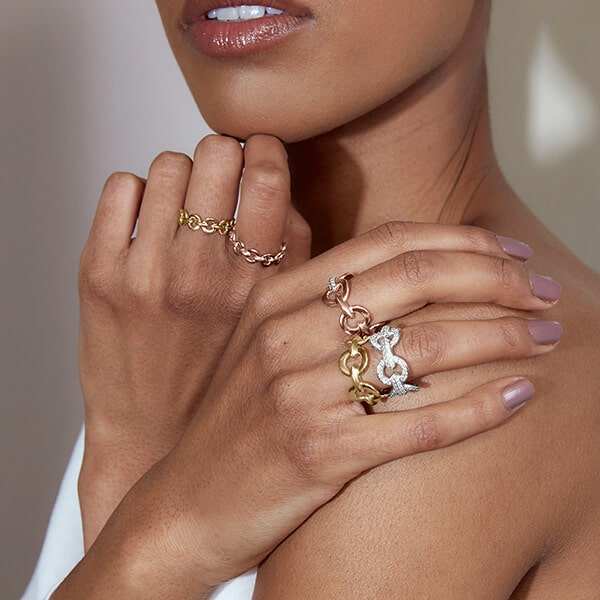 Model Wearing the Ecksand Pure Crown Stackable Ring in Yellow Gold and the Ecksand Pure Cuff Ring in Yellow Gold